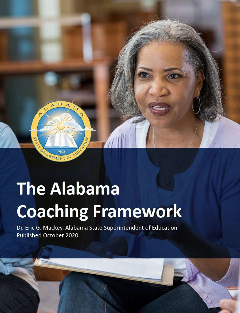 Woman talking with a text banner across the photo that reads, The Alabama Coaching Framework