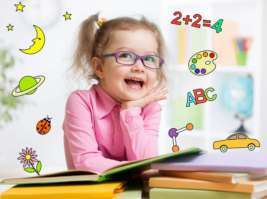 young girl in glasses with education-related graphics surrounding her