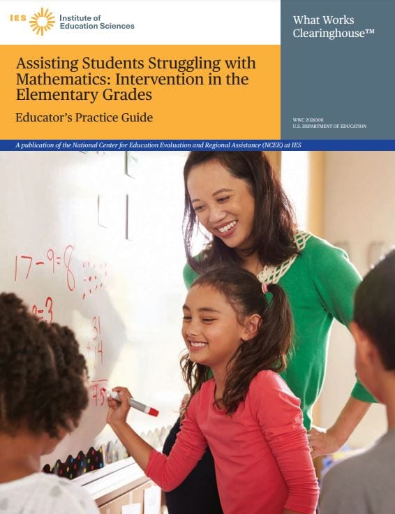 Teacher assisting students struggling with mathematics